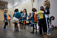 Team members from the Stillson School of Irish Dance in Portland, Maine, gets their costumes ready for competition at the 2013 World Championships for Irish Dancing in Boston, Massachusetts, USA.  The 2013 competition in Boston is the second time in the competition's 43-year history that the event has been held in the United States.