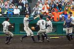 Tsuruga Kehi team group,<br /> APRIL 1, 2015 - Baseball :<br /> Tsuruga Kehi players celebrate their victory at the end of the 87th National High School Baseball Invitational Tournament final game between Tokai University Daiyon 1-3 Tsuruga Kehi at Koshien Stadium in Hyogo, Japan. (Photo by Katsuro Okazawa/AFLO)(L to R) Kizuku Nakai, Shota Hiranuma, Yuki Hayashinaka, Ryo Shinohara, Yusuke Kamon