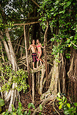 USA, Hawaii, The Big Island, hanging out in a banyan tree in Hilo