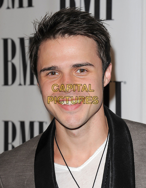 KRIS ALLEN.at The 2011 BMI Pop Music Awards held at The Beverly Wilshire Hotel in Beverly Hills, California, USA, May 17th 2011..portrait headshot smiling white t-shirt black                                                                                 .CAP/RKE/DVS.©DVS/RockinExposures/Capital Pictures.