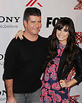 LOS ANGELES, CA - DECEMBER 06: Simon Cowell and Demi Lovato  arrive at the 'The X Factor' Viewing Party Sponsored By Sony X Headphones at Mixology101 & Planet Dailies on December 6, 2012 in Los Angeles, California.