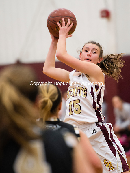 WATERBURY, CT- 11 January 2015-011116EC07-    Sacred Heart's Hayley Tucker grabs the ball during play with Woodland Monday night. Erin Covey Republican-American