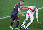 10.04.2013 Barcelona, Spain. Champions league Quarter-final row 2. Picture show Andres Iniesta (L) and Christophe Jallet(R)  in action during match between FC Barcelona against Paris SG at Camp Nou
