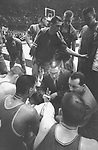 24 MAR 1962:  Ohio State coach Fred Taylor (center) talking strategy with his team during the NCAA Men's Basketball National Championship held in Louisville, KY. at Freedom Hall. Ohio State would loose to Cincinnati for the second straight year in the final game. Cincinnati defeated Ohio State 71-59 to win the championship. Photo Copyright Rich Clarkson