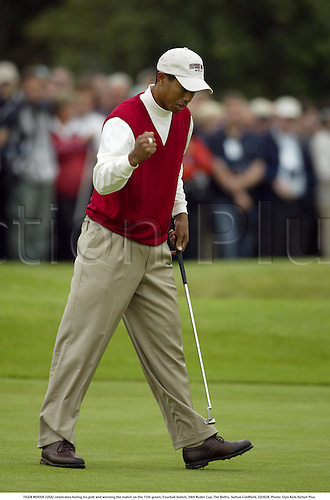 TIGER WOODS (USA) celebrates holing his putt and winning the match on the 15th green, Fourball Match, 34th Ryder Cup, The Belfry, Sutton Coldfield, 020928. Photo: Glyn Kirk/Action Plus....2002.golf golfing players.putting putt.celebrate celebrating celebration celebrations joy