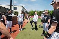 Women's basketball coach, Vic Schaefer, playing hacky sack with the softball team prior to first pitch against Florida.<br />  (photo by Beth Wynn / &copy; Mississippi State University)