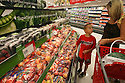 "Sarina Flores shops with her son Jeffrey, 8, at the new grocery section of the Murrieta Super Target in Murrieta, California in July, 2009. ""I'm excited the store is open,"" she said. ""It's close to home.""  photo for The Californian"