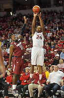 NWA Democrat-Gazette/Michael Woods --02/03/2015--w@NWAMICHAELW... University of Arkansas guard Michael Qualls pulls up for a jump shot over South Carolina's Duane Notice in the first half of Tuesday nights game against the South Carolina Gamecocks at Bud Walton Arena in Fayetteville.