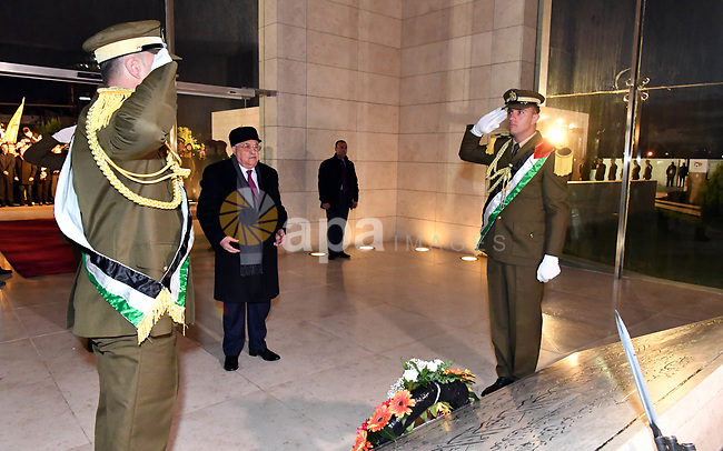 Palestinian president Mahmud Abbas looks on after laying wreath of flowers on the tomb of the late President Yasser Arafat during a celebration marking the fifty-third anniversary of the creation of the Fatah movement in the West Bank city of Ramallah on December 31, 2017. Photo by Thaer Ganaim