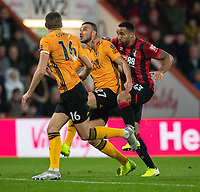 Wolverhampton Wanderers' Romain Saiss (centre) is tackled by Bournemouth's Callum Wilson (right) <br /> <br /> Photographer David Horton/CameraSport<br /> <br /> The Premier League - Bournemouth v Wolverhampton Wanderers - Saturday 23rd November 2019 - Vitality Stadium - Bournemouth<br /> <br /> World Copyright © 2019 CameraSport. All rights reserved. 43 Linden Ave. Countesthorpe. Leicester. England. LE8 5PG - Tel: +44 (0) 116 277 4147 - admin@camerasport.com - www.camerasport.com