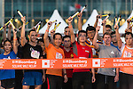 Start of the race at the Bloomberg Square Mile Relay near the Huangpu River in Shanghai, China. Photo by Marcio Machado / Power Sport Images