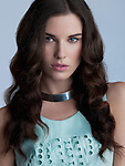 Beautiful brunette fashion models in green dress & silver necklace