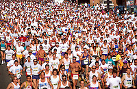 Overview of a field of runners at the start of a race.