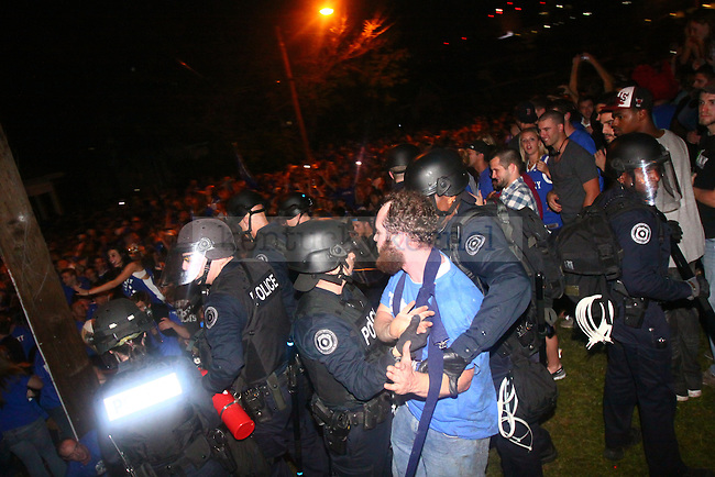 Fans celebrate on State St. after UK wins the National Championship. Photo by Scott Hannigan | Staf