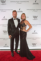 Michael McNeal and Kristen Swinehart pose for a photo on the red carpet during the Humane Society of the United States' Celebrating Animals Confronting Cruelty Gala, Friday, March 11, 2016 in Miami. The event benefitted the HSUS Animal Rescue Team and South Florida Wildlife Center, and honored Joanna Krupa with the Inspirational Honoree Award, and LUSH Cosmetics with the Corporate Consciousness Award. (Jesus Aranguren/AP Images for The Humane Society of the United States)