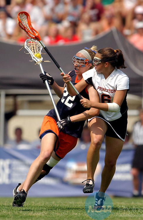 23 MAY 2004:  Attacker Caitlin Banks (22) of the University of Virginia and midfielder Mary Beth Hogan (6) of Princeton battle for the ball during the Division I Women's Lacrosse Championship held at Princeton Stadium in Princeton, NJ.  Virginia defeated Princeton 10-4 for the national title.  Larry French/NCAA Photos