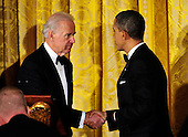 United States President Barack Obama, right, and U.S. Vice President Joe Biden shakes hands as the President prepares to make remarks at a dinner hosted by he and and first lady Michelle Obama to honor our Armed Forces who served in Operation Iraqi Freedom and Operation New Dawn and to honor their families in the East Room of the White House in Washington, D.C. on Wednesday, February 29, 2012..Credit: Ron Sachs / Pool via CNP