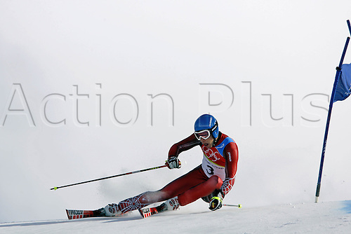 20 February 2006: Austrian skier Benjamin Raich (AUT) skiing during his second run in the Men's Giant Slalom at the Sestriere sub-area Colle during the 2006 Turin Winter Olympics. Raich finished in first place. Photo: Neil Tingle/actionplus..060220 torino male man men ski skiing snow