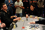 Vanessa Selbst, right, look towards her opponent, Ryan Bambrick, right, after exposing her cards to reveal a straight.  The hand knocked out Bambrick.