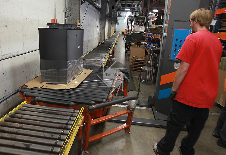 Empire Comfort Systems employee Robert Schaffer watches as a finished unit is spun around and shrink-wrapped in the packing department. The Belleville manufacturing firm is celebrating its 80th anniversary.