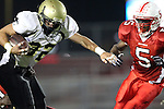 Lawndale, CA 10/01/10 - Ryan Sawelson (Peninsula #32) and Aaron Fowler (Lawndale #5) in action during the Peninsula-Lawndale Varsity football game.