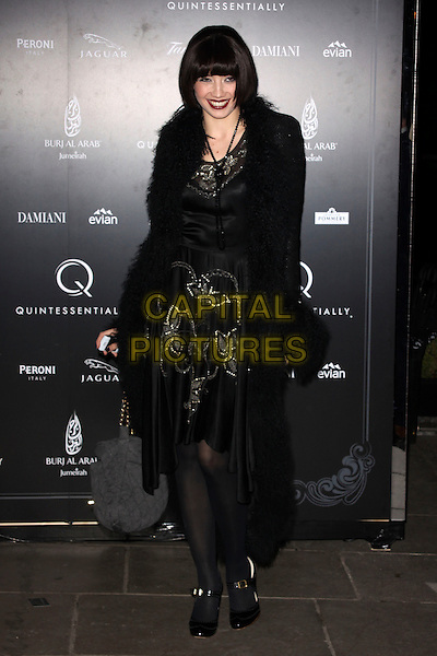 DAISY LOWE.The Quintessentially 10th anniversary party, Savoy hotel, London, England..December 13th, 2010.full length coat dress print tights mary janes shoes black fur furry beads necklace .CAP/AH.©Adam Houghton/Capital Pictures.