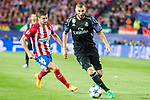 Karim Benzema (r) of Real Madrid competes for the ball with Gabriel Fernandez Arenas, Gabi, of Atletico de Madrid during their 2016-17 UEFA Champions League Semifinals 2nd leg match between Atletico de Madrid and Real Madrid at the Estadio Vicente Calderon on 10 May 2017 in Madrid, Spain. Photo by Diego Gonzalez Souto / Power Sport Images