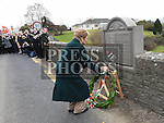 Joan Dorey the Niece of Philip Clarke from Monknewtown, Rossin Slane who was killed in the 1916 rising lays a wreath at Rossin Bridge. Photo:Colin Bell/pressphotos.ie