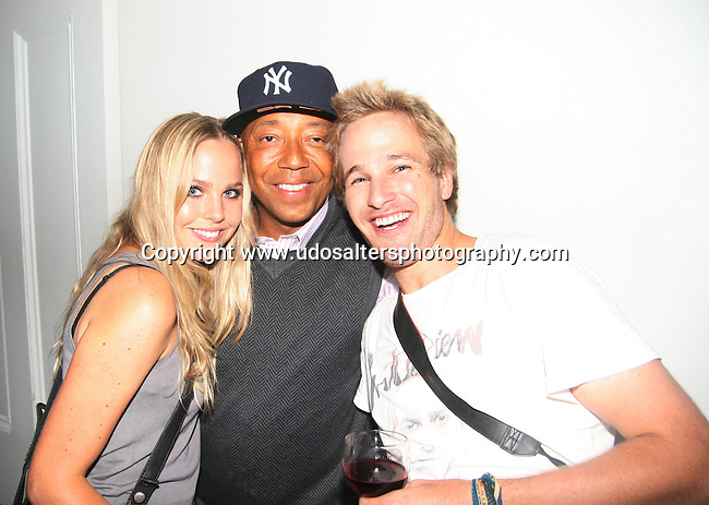 Ulrika Sebastian, Russell Simmons and Lindstrom Sebastian attend screening of The Cove hosted by Russell Simmons at Norwood Club, New York Photo by Derrick Salters
