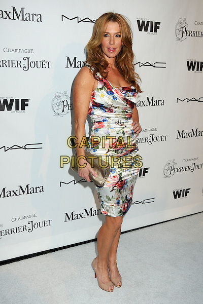POPPY MONTGOMERY .3rd Annual Women In Film Pre-Oscar Party held at a Private Residence in Beverly Hills, California, USA, .4th March 2010..full length sleeveless dress hand on hip  floral red white blue print flower ruched gold clutch bag   beige peep silk satin  toe shoes .CAP/ADM/BP.©Byron Purvis/AdMedia/Capital Pictures.