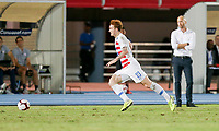 GEORGETOWN, GRAND CAYMAN, CAYMAN ISLANDS - NOVEMBER 19: Josh Sargent #19 of the United States moves with the ball as USMNT coach Gregg Berhalter looks on during a game between Cuba and USMNT at Truman Bodden Sports Complex on November 19, 2019 in Georgetown, Grand Cayman.