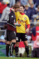 MetroStars' goalkeeper Zach Wells gets a post game hug from Hall of Fame inductee Eric Wynalda who got to play for the Fire during the second half. The MetroStars defeated the Chicago Fire 2-0 during an exhibition game on Monday October 11, 2004 at At-A-Glance Field at the National Soccer Hall of Fame and Museum, Oneonta, NY..