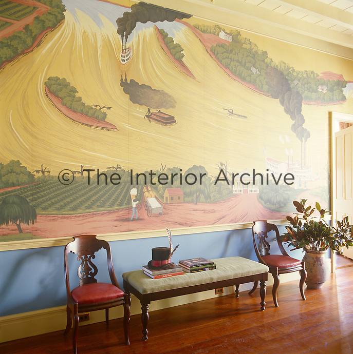 The walls of the living room are decorated with a scenic scene which was designed by Thomas Jayne in conjunction with de Gournay wallpaper