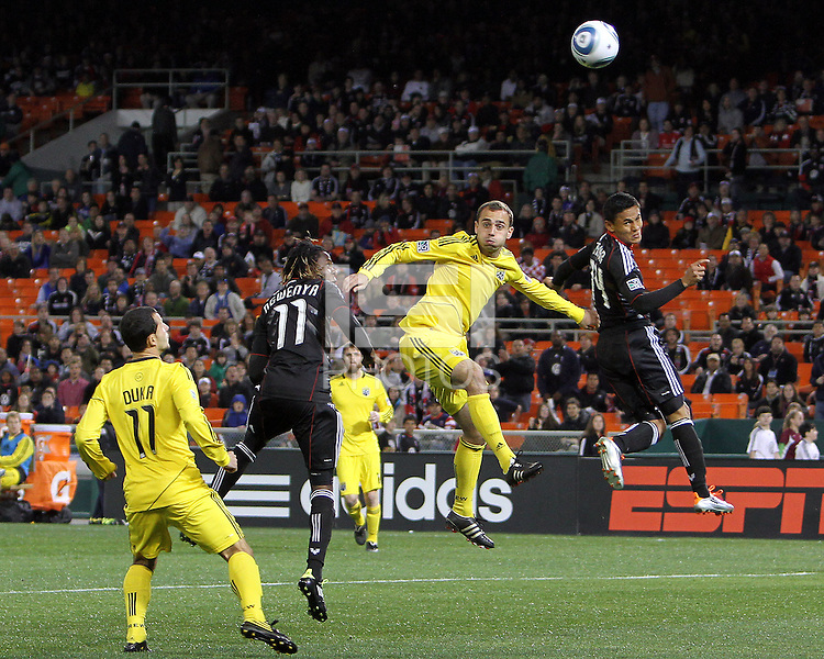 Andy Najar#14 of D.C. United heads away from Dejan Rusmir#22 of the Columbus Crew during the opening match of the 2011 season at RFK Stadium, in Washington D.C. on March 19 2011.D.C. United won 3-1.