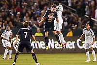 Omar Gonzalez (4) of the LA Galaxy battles with Stefani Miglioranzi (6) of the Philadelphia Union. The LA Galaxy defeated the Philadelphia Union 1-0 at Home Depot Center stadium in Carson, California on  April  2, 2011....