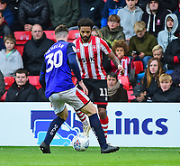 Lincoln City's Bruno Andrade vies for possession with Crewe Alexandra's Corey Whelan<br /> <br /> Photographer Andrew Vaughan/CameraSport<br /> <br /> The EFL Sky Bet League Two - Lincoln City v Crewe Alexandra - Saturday 6th October 2018 - Sincil Bank - Lincoln<br /> <br /> World Copyright &copy; 2018 CameraSport. All rights reserved. 43 Linden Ave. Countesthorpe. Leicester. England. LE8 5PG - Tel: +44 (0) 116 277 4147 - admin@camerasport.com - www.camerasport.com