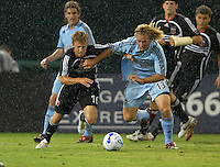 DC United midfielder Brian Carroll (16) fights for possession of the ball against Colorado Rapids defender Stephen Keel (13) in heavy rain. DC United defeated the Colorado Rapids 4-1, at RFK Stadium in Washington DC, Thursday June 28, 2007.