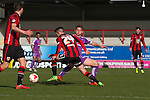 Home side's Luke Conlon in first-half action against Chelsea-loanee Jordan Houghton as Morecambe (red stripes) hosted Plymouth Argyle in a League 2 fixture at the Globe Arena. The stadium was opened in 2010 and replaced Morecambe's traditional home of Christie Park which had been their home since 1921, the year after their foundation. Plymouth won this fixture by 2-0 watched by 2,081 spectators, in a game delayed by 30 minutes due to traffic congestion affecting travelling Argyle fans.