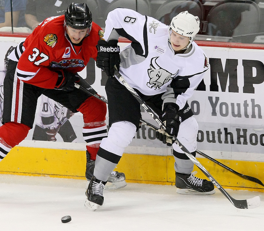 San Antonio Rampage's Oliver Ekman-Larsson, right, battles Rockford IceHogs' Rob Klinkhammer for the puck during the first period of an AHL hockey game, Tuesday, April 5, 2011, in San Antonio. (Darren Abate/pressphotointl.com)
