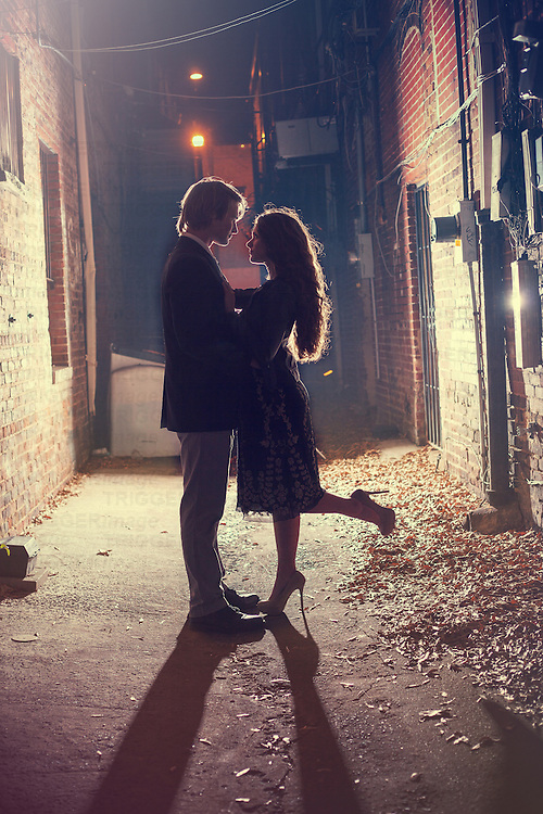 Couple in an alley having a romantic moment