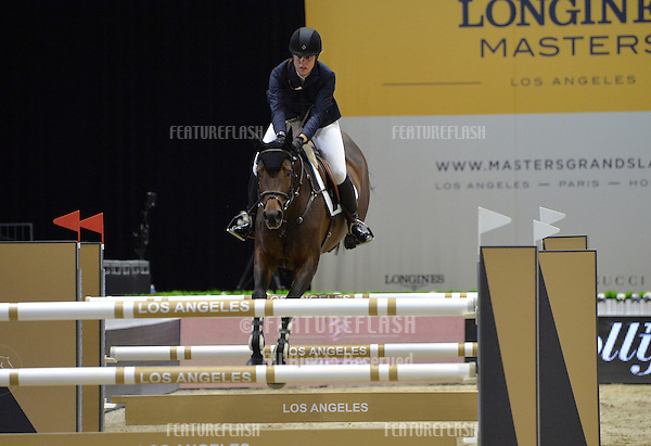 Emmanuelle Mille (France) riding Coquette in the Antoine Mouex Propri&eacute;t&eacute;s International jumping competition at the 2015 Longins Masters Los Angeles at the L.A. Convention Centre.<br /> October 1, 2015  Los Angeles, CA<br /> Picture: Paul Smith / Featureflash