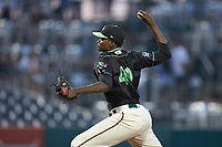 Ocelotes de Greensboro relief pitcher Yerry De Los Santos (49) in action against the Hickory Crawdads at First National Bank Field on June 11, 2019 in Greensboro, North Carolina. The Crawdads defeated the Ocelotes 2-1. (Brian Westerholt/Four Seam Images)
