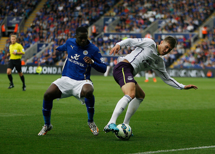 Leicester City's Jeffrey Schlupp (L) and Everton's John Stones in action during todays match  <br /> <br /> Photographer Jack Phillips/CameraSport<br /> <br /> Football - Barclays Premiership - Leicester City v Everton - Saturday 16th August 2014 - King Power Stadium - Leicester<br /> <br /> &copy; CameraSport - 43 Linden Ave. Countesthorpe. Leicester. England. LE8 5PG - Tel: +44 (0) 116 277 4147 - admin@camerasport.com - www.camerasport.com
