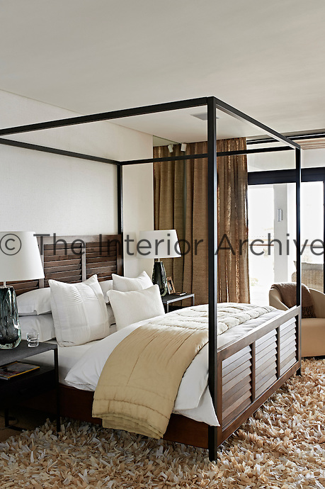 This contemporary house is an exercise in purity and harmony, where restraint and bleached colour allow simplicity and custom-made comfort to come to the fore as a luxury. Warm tones, natural materials and textures characterise a guest bedroom.
