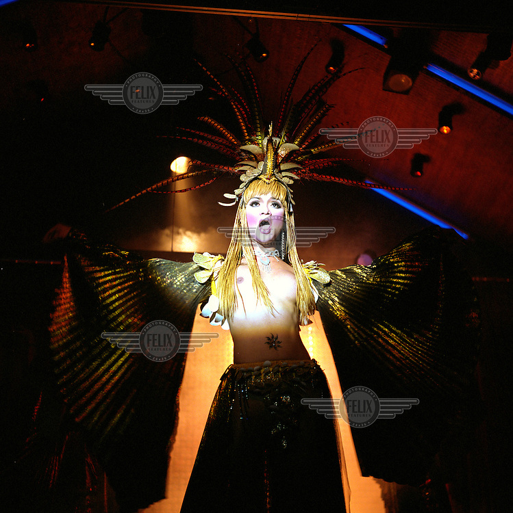 A katoey (or kathoey) performer wearing an elaborate costume performs in one of the many nightclubs on the island. The term 'katoey', often translated as 'ladyboy', refers to both Thai transvestites and transsexuals.