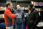 WATERBURY,  CT-122916JS07--U.S. Sen. Christopher Murphy, left, talks with drop in clients Jason Shuster, center, and Charles Watson, right, both of Waterbury, during his visit to CHD Hospitality Center on East Main Street in Waterbury on Thursday. The center is for people who are homeless, giving them a chance to escape the harshness of living on the street, take a shower, use a computer or telephone, collect main and receive information to hep to transition out of homelessness. Jim Shannon Republican-American