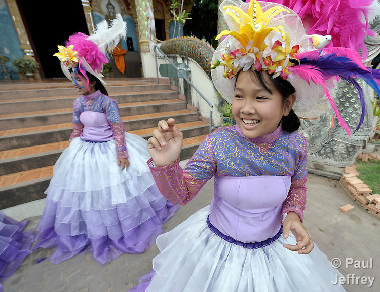 Yossarin Mahawongsanan (right) participates in a dance group organized by the Hualin Buddhist Temple in the northern Thailand village of Toong-sa-tok. The group, which performs for weddings and other celebrations and uses the proceeds for its members' educational expenses, includes orphans and other vulnerable girls, many of them affected by HIV and AIDS.