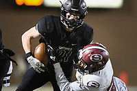 NWA Democrat-Gazette/CHARLIE KAIJO Bentonville wide receiver Trenton Kolb (21) carries the ball, Friday, November 1, 2019 during a football game at Bentonville High School in Bentonville.