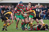 Ethan James has Josh Chamberlain and Caleb Brown to contend with as he brings the ball forward. Counties Manukau Premier Club Rugby game between Waiuku and Bombay, played at Waiuku on Saturday July 5th 2010. Waiuku won 59 - 14 after trailing 12 - 14 at halftme.