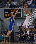 Nevada forward Caleb Martin (10) shoots a three pointer               over San Jose State guard Brae Ivey (2) in the second half of an NCAA college basketball game in Reno, Nev., Wednesday, Jan. 9, 2019. (AP Photo/Tom R. Smedes)
